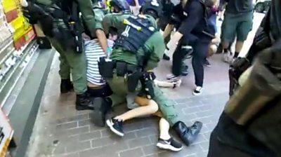 hong-kong:-police-tackle-12-year-old-to-the-ground-in-hong-kong