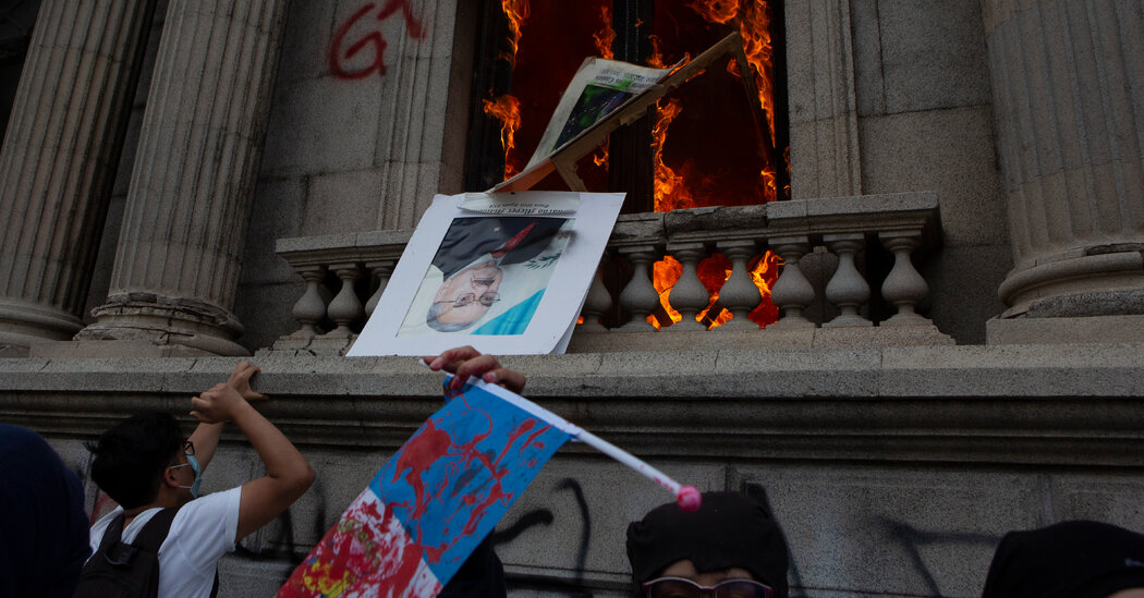 protesters-in-guatemala-set-fire-to-congress-building-over-spending-cuts