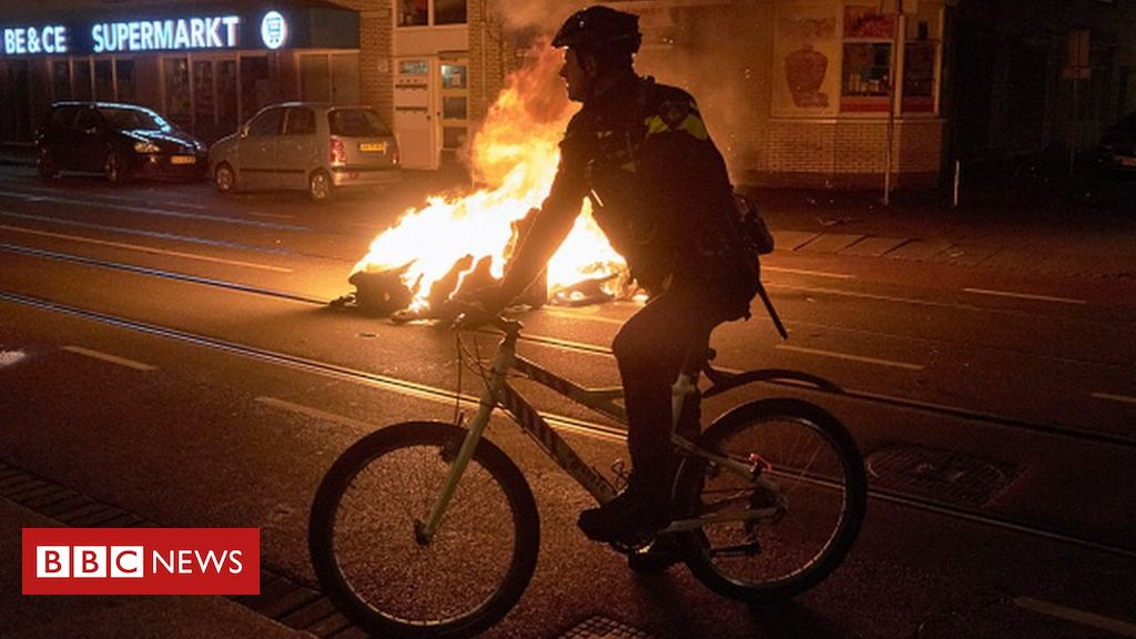 covid:-dutch-curfew-riots-rage-for-third-night