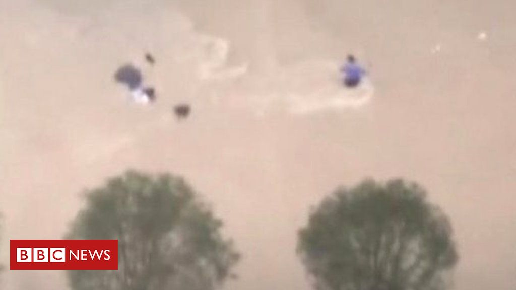 henan-floods:-woman-swept-down-street-by-extreme-flood-waters